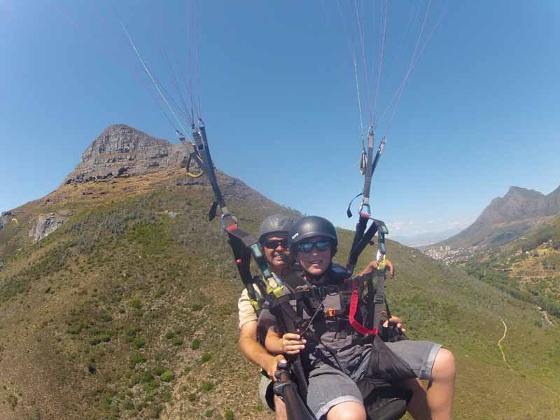 Me Paragliding with my Driver and Lions Head in the background